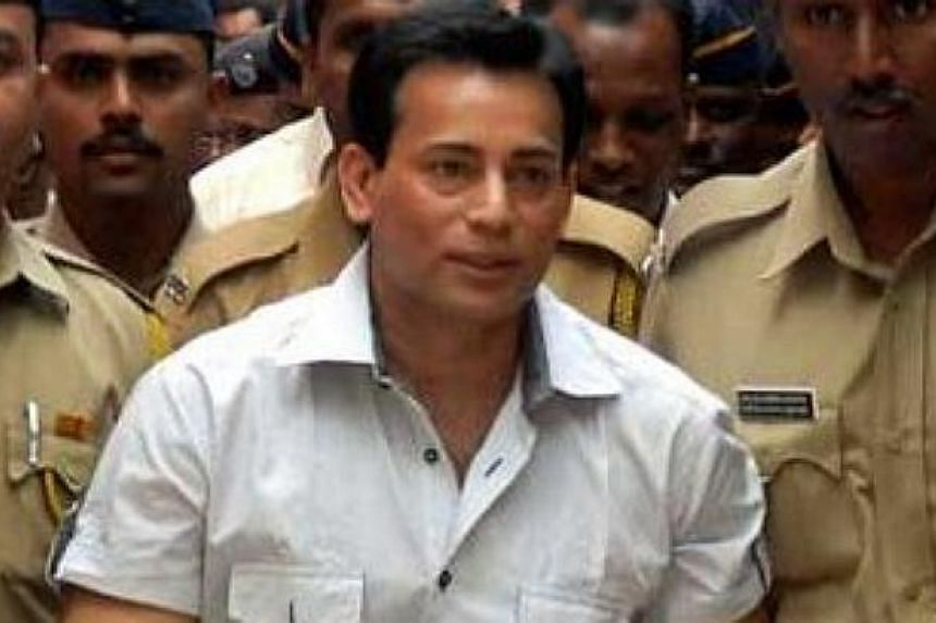 A Mumbai court on Wednesday, Feb 25, 2015, sentenced Abu Salem, once one of India's most feared gangsters, to life in prison for the murder of a builder two decades ago. -- PHOTO: THE STATESMAN/ASIA NEWS NETWORK