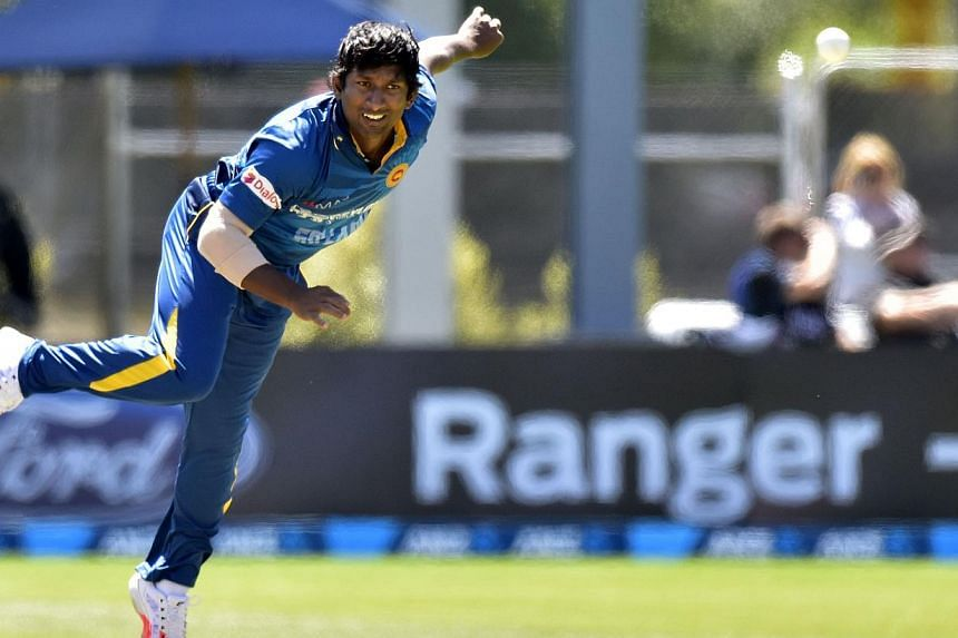 Sri Lanka's Jeevan Mendis bowls during the fifth One Day International cricket match between New Zealand and Sri Lanka in Dunedin at University Oval on Jan 23, 2015. -- PHOTO: AFP