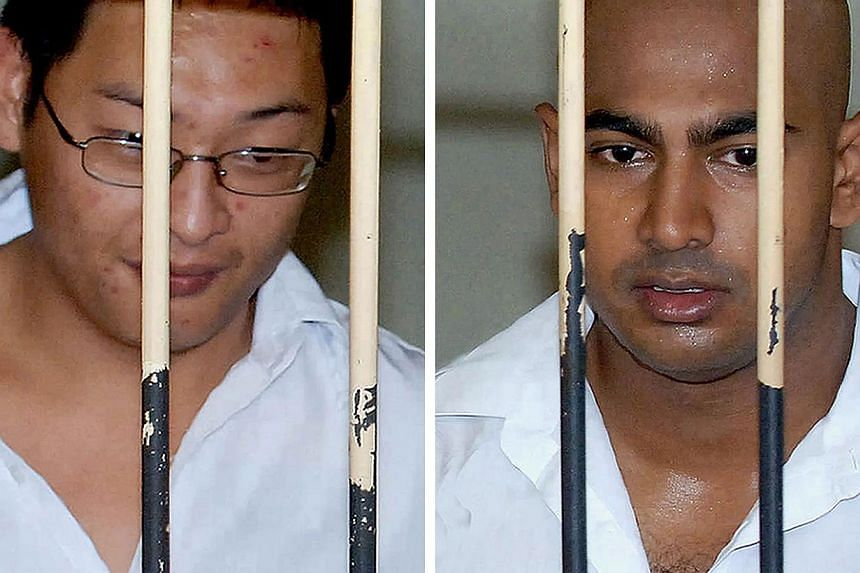 """In this file combo photograph taken on Feb 14, 2006, Australian drug smugglers Andrew Chan (left) and Myuran Sukumaran, the ringleaders of the """"Bali Nine"""" drug ring, are seen at a court holding cell during their trial in Denpasar, in Bali resort isla"""