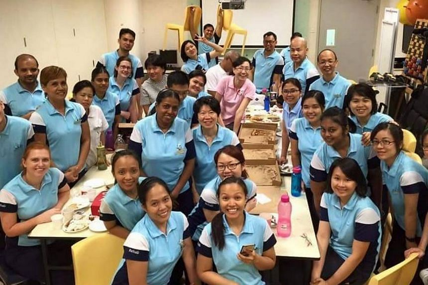 Ms Orsi (bottom left) with her colleagues at Bright Vision Hospital. -- PHOTO: FACEBOOK
