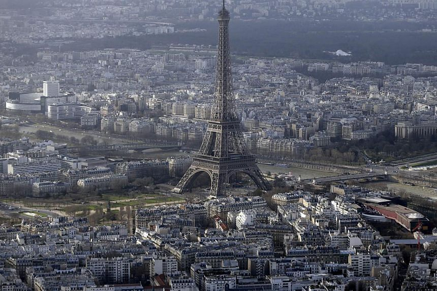 An aerial file photo taken on Jan 11 shows the Eiffel Tower in Paris. At least five drones were spotted flying over central Paris landmarks during the night and police were unable to catch the operators, sources close to the probe said on Tuesday. --