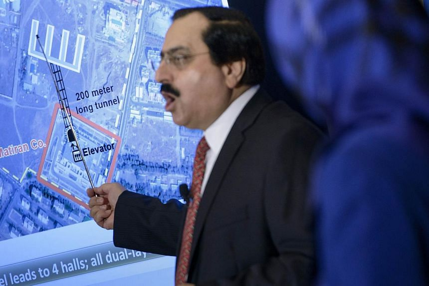Alireza Jafarzadeh of the National Council of Resistance shows satellite photos during a press conference at the National Press Club on Tuesday in Washington, DC. -- PHOTO: AFP