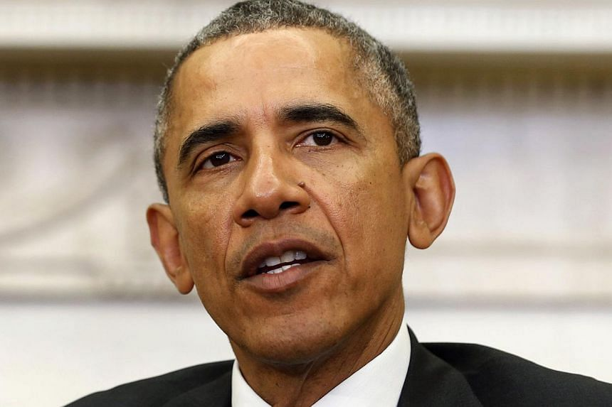 Us President Barack Obama speaking in the Oval Office at the White House in Washington, DC on Tuesday. -- PHOTO: REUTERS