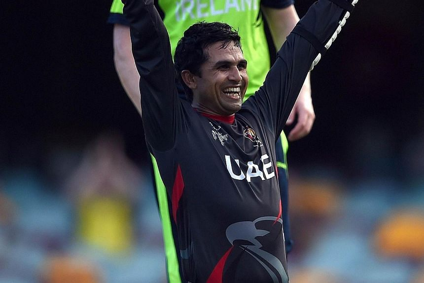 United Arab Emirates (UAE) batsman Shaiman Anwar celebrates after scoring his century during the 2015 Cricket World Cup Pool B match between Ireland and UAE at the Gabba cricket stadium in Brisbane on Feb 25, 2015. -- PHOTO: AFP