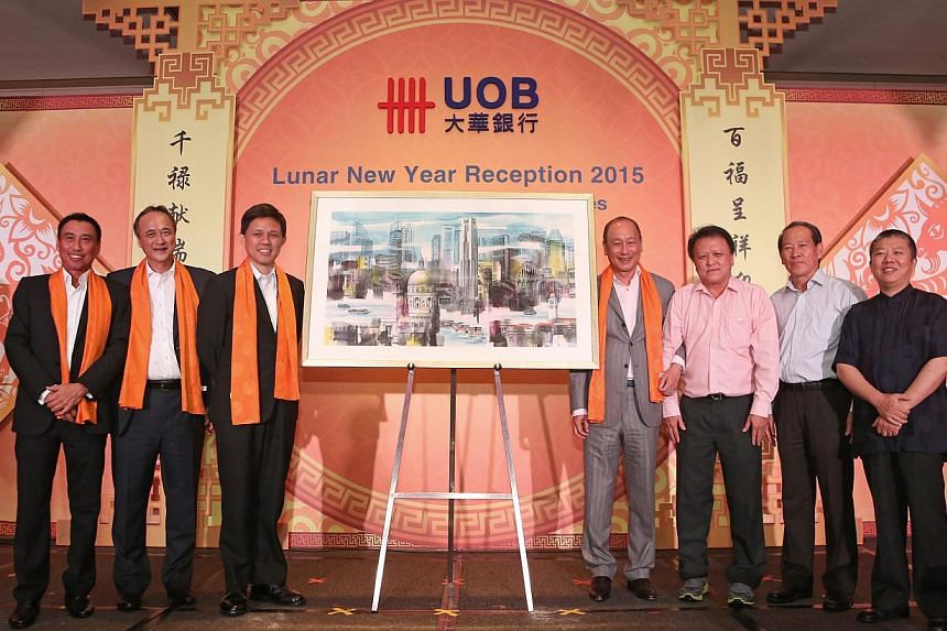A brush of good luck at the UOB Commercial Banking Lunar New Year dinner. (From left) Mr Eric Tham, Managing Director, Group Commercial Banking, UOB Group, Mr Fred Chin, Managing Director, Group Wholesale Banking, UOB Group, Minister Chan Chun Sing,