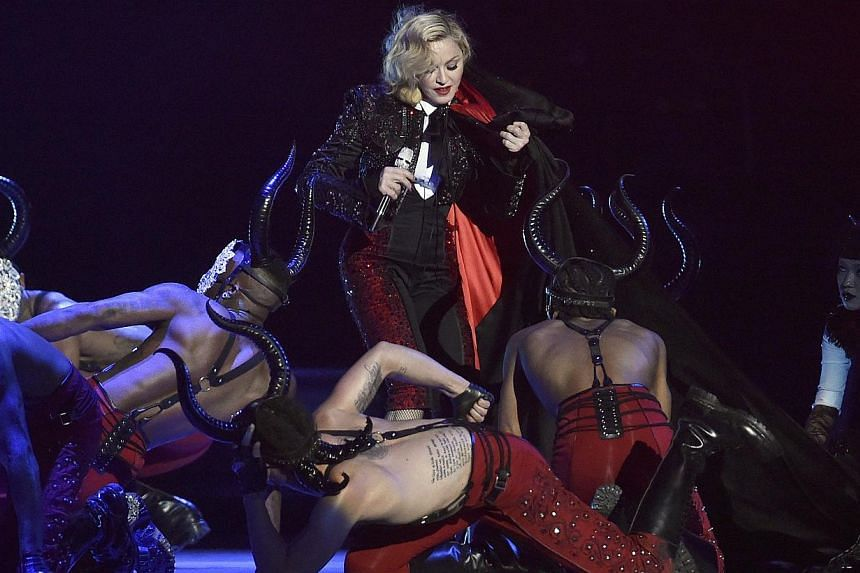 Madonna struggles with her cape after falling during her performance at theBrit music awards at the O2 Arena in Greenwich, London, on Feb 25, 2015. -- PHOTO: REUTERS