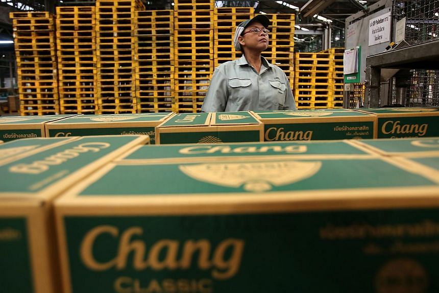A worker inspects boxes of Thai Beverage (ThaiBev) Chang beer at the company's Beer Thip brewery in Bang Ban, Ayutthaya province, Thailand, on Friday, Oct 5, 2012. -- PHOTO: BLOOMBERG
