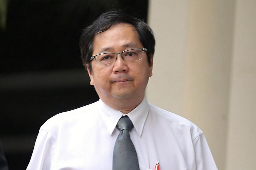 Dr Tan Gek Youngwas charged in the State Courts on Thursday with failing to keep proper records when dispensing a significant amount of cough medicine containing codeine. -- ST PHOTO: WONG KWAI CHOW