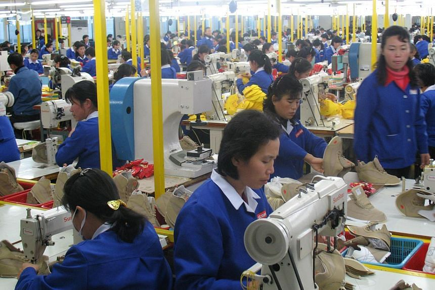 North Korean workers at a garment factory within the Kaesong Industrial Complex. North Korea notified South Korea on Thursday, Feb 26, 2015, of a raise in the minimum wage for workers in the joint complex, a unilateral move immediately rejected by Se