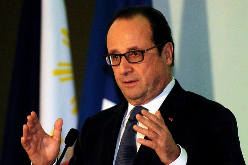 """French President Francois Hollande on Thursday, Feb 26, 2015, condemned a group of French lawmakers for meeting with Syrian President Bashar al-Assad, whom he branded a """"dictator"""". -- PHOTO: AFP"""