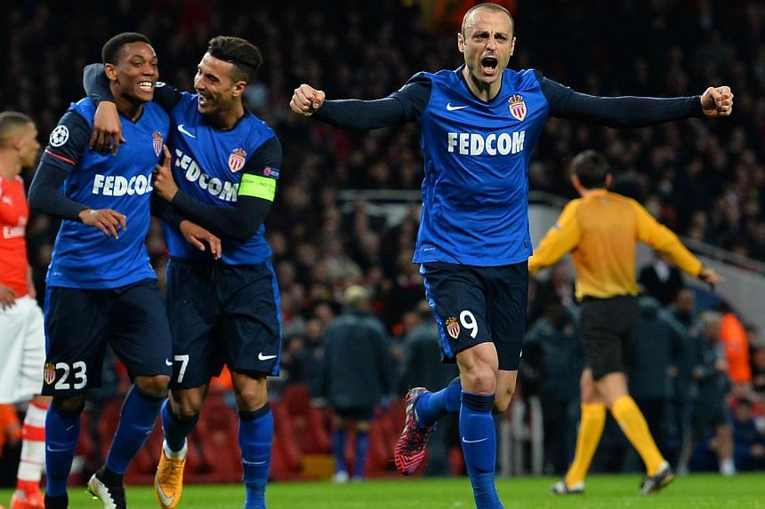 Monaco's Bulgarian forward Dimitar Berbatov (right) celebrating after scoring his team's second goal against Arsenal at the Emirates Stadium in London on Feb 25, 2015. -- PHOTO: AFP