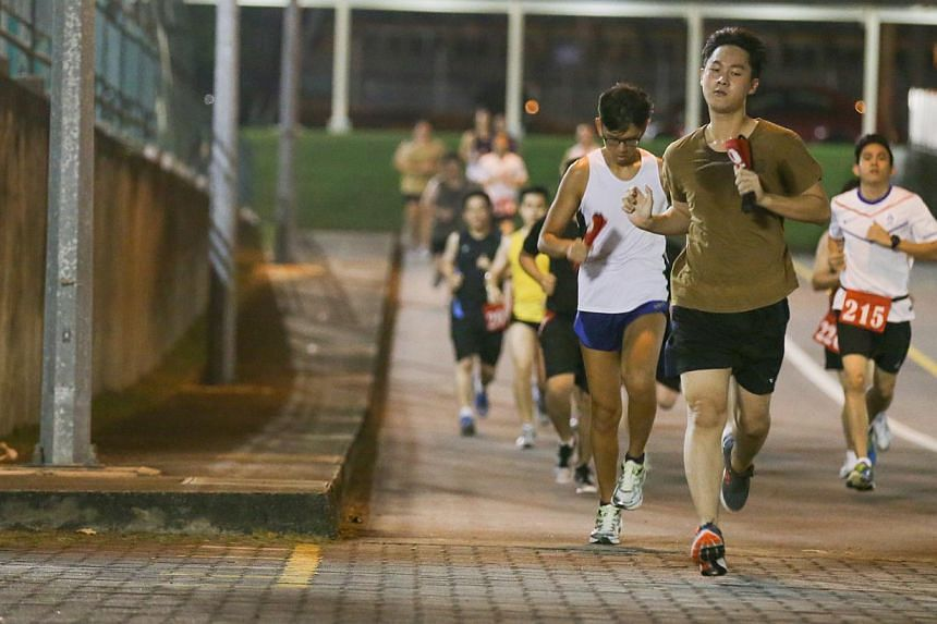 Operationally ready national servicemen (NSmen) running as part of IPPT Preparatory Training (IPT) programme in Maju Camp on Sept 8, 2014. -- ST PHOTO: ONG WEE JIN