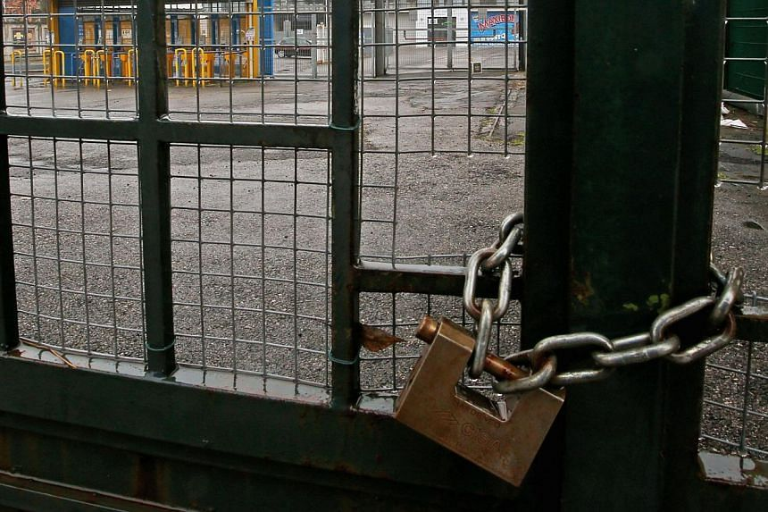 The entrance gates of the Ennio Tardini stadium in Parma are padlocked Feb 22, 2015 ahead of the scheduled Serie A soccer match against Udinese. The match has been called off because the bank account of bankruptcy-threatened Parma is reported to be a