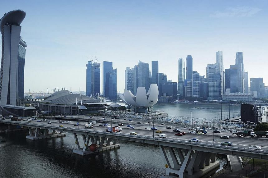 Singapore's Budget 2015 announcement on higher tax allowances for mergers and acquisitions is heartening. It is now easier for SMEs to gain opportunities for significant inorganic growth. -- PHOTO: BLOOMBERG