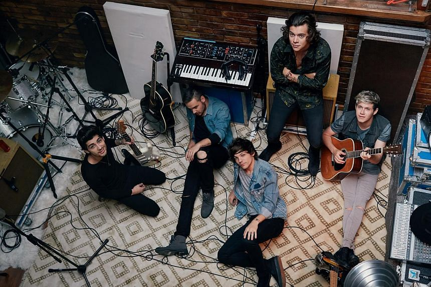 (From left) Zayn Malik, Liam Payne, Louis Tomlinson, Harry Styles and Niall Horan make up One Direction, the top British act for the third year running. -- PHOTO: SONY MUSIC
