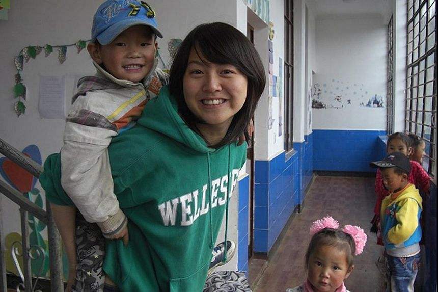 Miss Davina Huang with children at a kindergarten in Yunnan, China, during a teaching stint in 2011. The school will be one of the beneficiaries of funds originally raised to help her family with the medical costs.