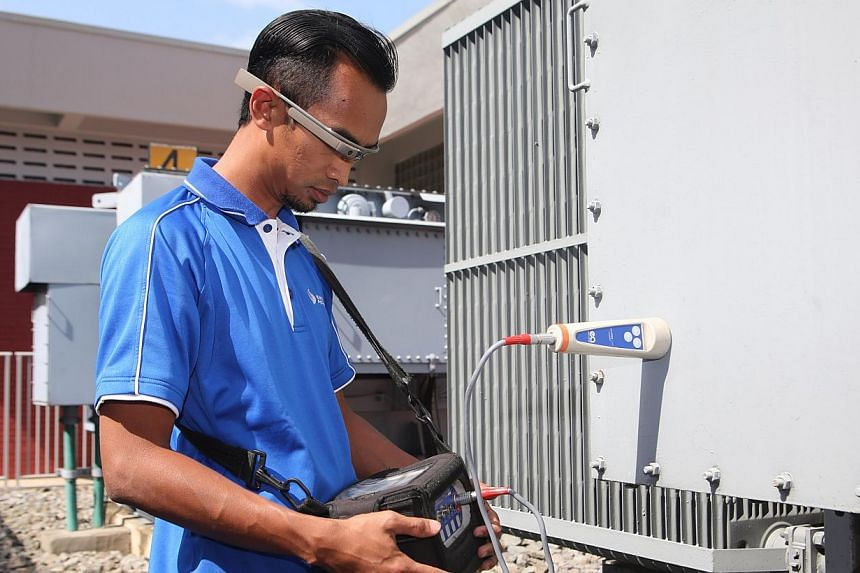 Staff at Singapore Power (SP) will use wearable technology to raise productivity and cut costs. -- PHOTO: SINGAPORE POWER