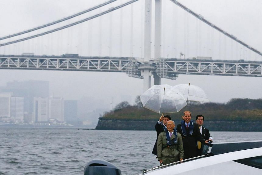 Tokyo Governor Yoichi Masuzoe (front left) poses with Britain's Prince William (front right) on a boat in front of the skyline of Tokyo onFeb 26, 2015, during his first trip to Japan. -- PHOTO: REUTERS