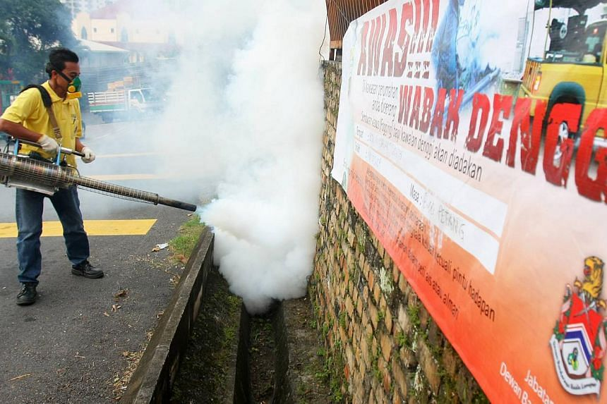 A worker carrying out fogging in mosquito breeding areas in Kuala Lumpur. Malaysia's Health Ministry is trying outdoor spraying of a deltamethrin-based insecticide to kill Aedes mosquitoes in view of the record high number of dengue fever cases recen