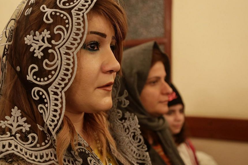 Assyrian Christians from Iraq, Syria and Lebanon at a Christmas mass in Beirut on Dec 25, 2014. The kidnapping of dozens of Assyrian Christians by the Islamic State in Iraq and Syria militant group in Syria has prompted an exodus of terrified familie