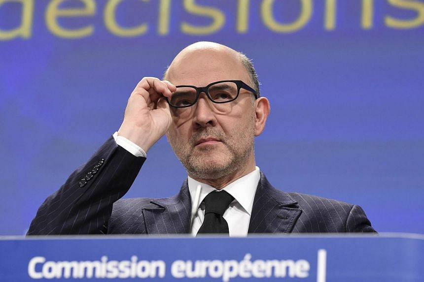 EU economic and financial affairs commissioner Pierre Moscovici gives a press conference on Feb 25, 2015 at the EU Parliament in Brussels. The EU on Feb 25 gave France a further two years until 2017 to bring its budget deficit back into line with Bru