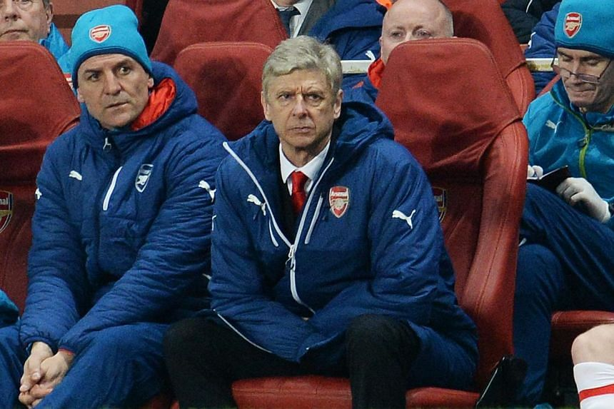 Arsenal manager Arsene Wenger looks on during the club's Champions League match against Monaco, which they lost 3-1, at the Emirates Stadium in London on Feb 25, 2015. Wenger gave a scathing review of his team's poor peformance at the match, calling