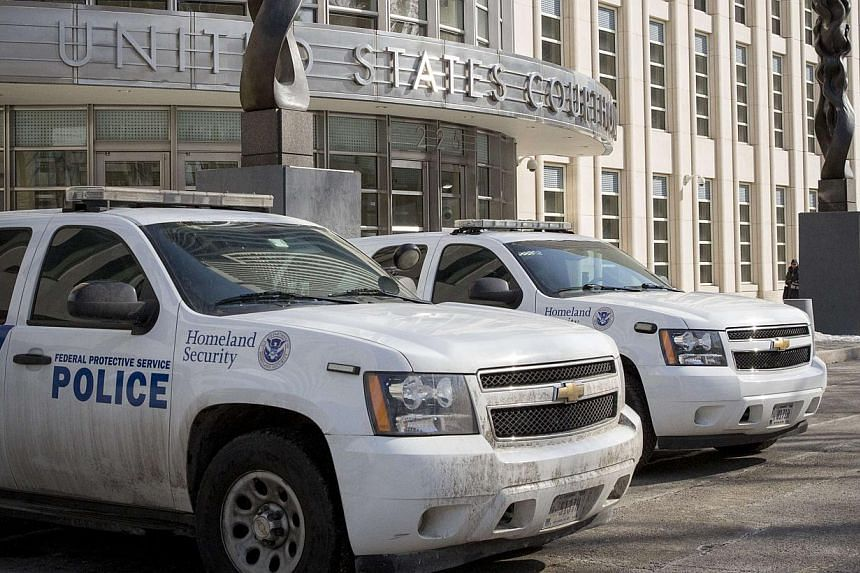 Federal Protective Service vehicles, which is a branch of Homeland Security, park outside the US District Courthouse in the Brooklyn borough of New York February 25, 2015. Senate Democrats on Wednesday agreed to a Senate Republican plan to avert a pa