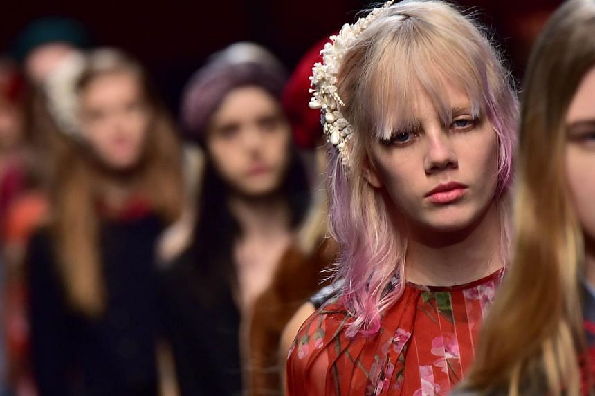 Models present creations for fashion house Gucci at the women Fall/Winter 2015/16 Milan's Fashion Week on Feb 25, 2015 in Milan. -- PHOTO: AFP