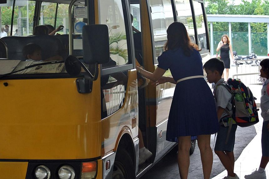 Parents with primary school-going children who receive financial aid from the Government welcomed transport subsidies announced in the Budget on Monday. -- PHOTO: THE NEW PAPER