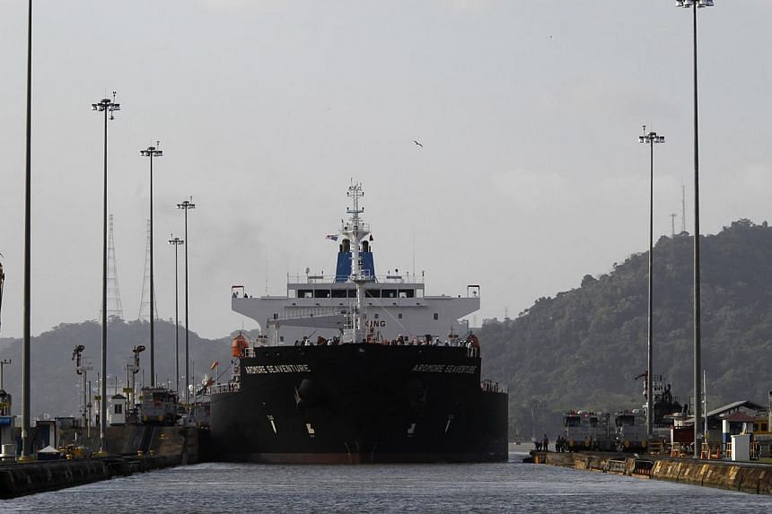 A cargo ship at the Miraflores locks in Panama City on Dec 31, 2014. Blacklisted North Korean shipping company Ocean Maritime Management Company has renamed most of its vessels in a bid to disguise their origin and continue its illicit shipments in v