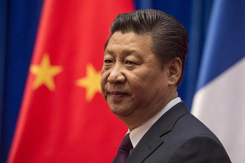 """Mr Xi's best-known slogan so far has been his call for the """"Chinese dream"""", an ambiguous catchphrase leaders have said refers to national rejuvenation in everything from ties with Taiwan to China's space programme. -- PHOTO: REUTERS"""