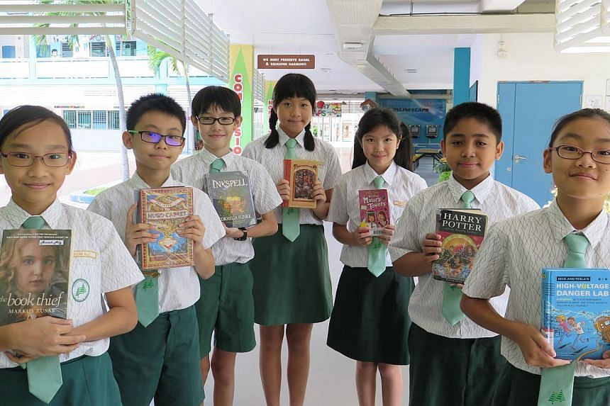 Casuarina Primary pupils who will be taking part in the preliminary round of the National Spelling Championship on Mar 7. (From left) They are Aisyah Shaik Ahmed Ally, Poh Zhi Nan, Soh Jue Ning, Charmaine Lee, Tan Qian Xun, Muhammad Daanish Zuklife a