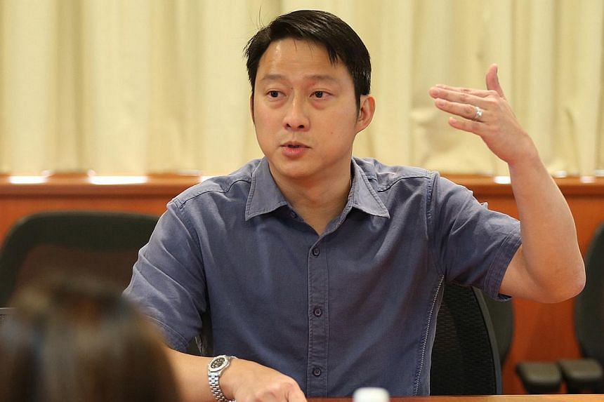 People's Action Party (PAP) MP Lam Pin Min (above) has been accused of making racially seditious comments by film-maker Martyn See, who has made a police report against the MP on Thursday. -- ST PHOTO: NEO XIAOBIN