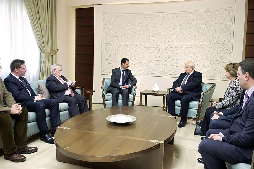 A handout picture released by the Syrian Arab News Agency (SANA) on Feb 25, 2015, shows Syrian President Bashar al-Assad (centre, left) meeting with French socialist senator, Jean-Pierre Vial (centre,right), along with three other French parliamentar