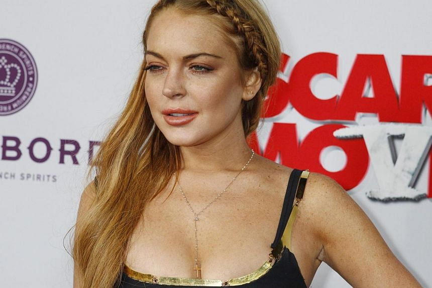 Actress Lindsay Lohan (above) on Wednesday was ordered to perform 125 additional hours of community service as part of her probation, her lawyer said, following a dispute over whether she performed the work. -- PHOTO: REUTERS