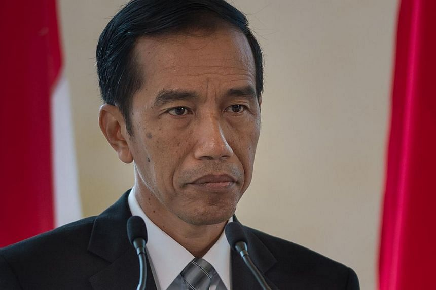 """Indonesian President Joko Widodo is """"carefully considering his position"""" on two Australians facing imminent execution for drug trafficking, says Australian Prime Minister Tony Abbott. -- PHOTO: AFP"""