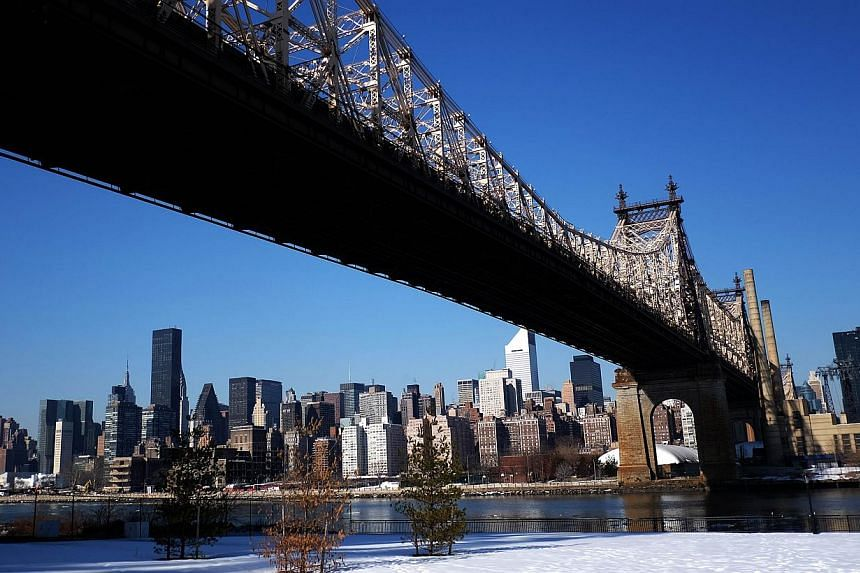 The skyline of New York's Midtown Manhattan is pictured from under the Queens Bridge on Feb 25, 2105 in New York. Three New York residents from Kazakhstan and Uzbekistan have been arrested for allegedly trying to join the Islamic State group fighting