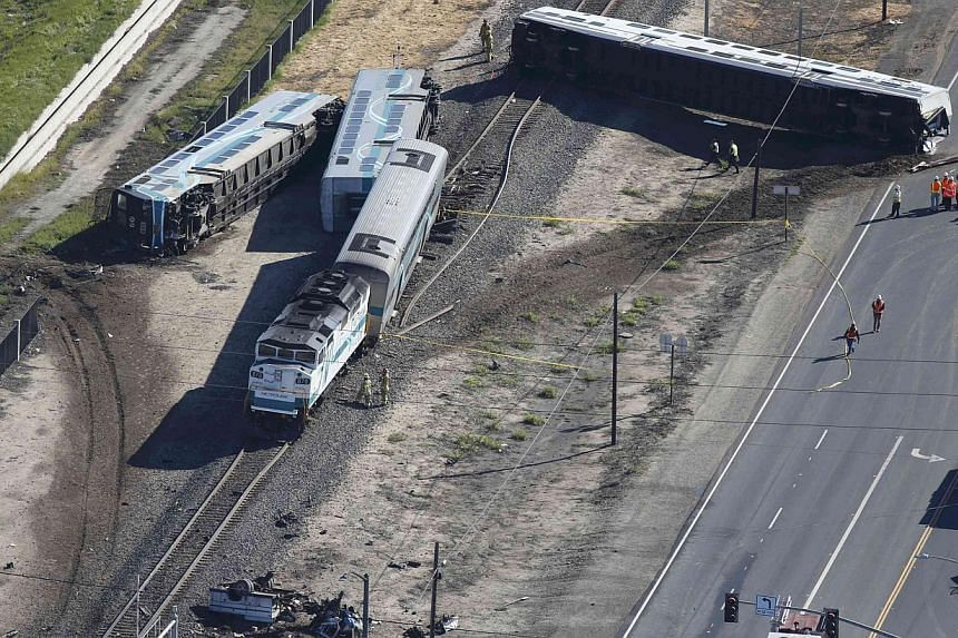 An aerial view of the scene of the train crash in Oxnard, California, on Feb 24, 2015. Video recorders on the train that struck a truck captured the crash, a federal official has said. -- PHOTO: REUTERS
