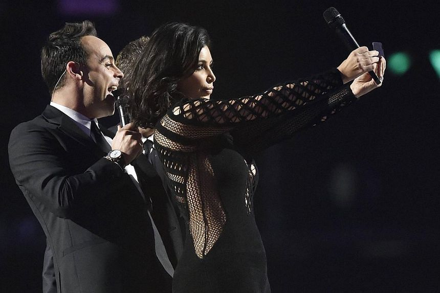Kim Kardashian poses for a selfie with presenters Ant and Dec at the BRIT music awards at the O2 Arena in Greenwich, London, on Feb 25, 2015. -- PHOTO: REUTERS