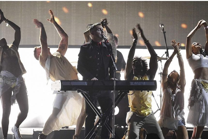 Pop group Take That performs at the BRIT music awards at the O2 Arena in Greenwich, London, on Feb 25, 2015. -- PHOTO: REUTERS