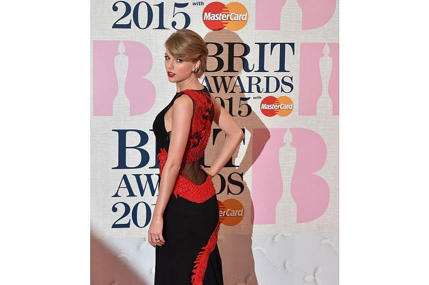 US singer Taylor Swift poses on the red carpet to attend the BRIT Awards 2015 in London on Feb 25, 2015. -- PHOTO: AFP