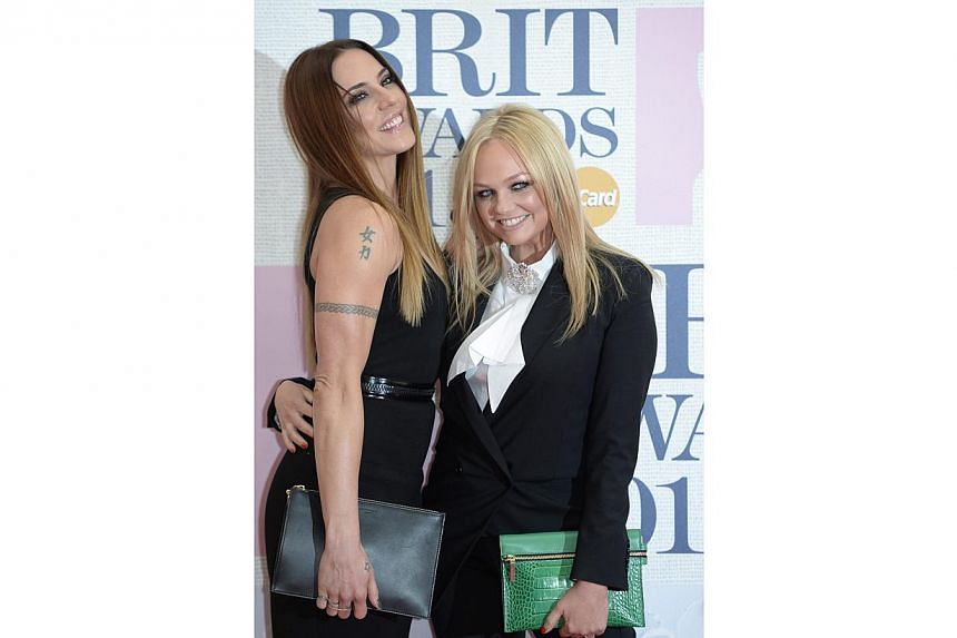 Former Spice Girls Melanie Chisholm (left, aka Sporty Spice) and Emma Bunton (aka Baby Spice) arrive for the BRIT Awards ceremony at the O2 Arena in Greenwich, London, Britain, on Feb 25, 2015. -- PHOTO: EPA
