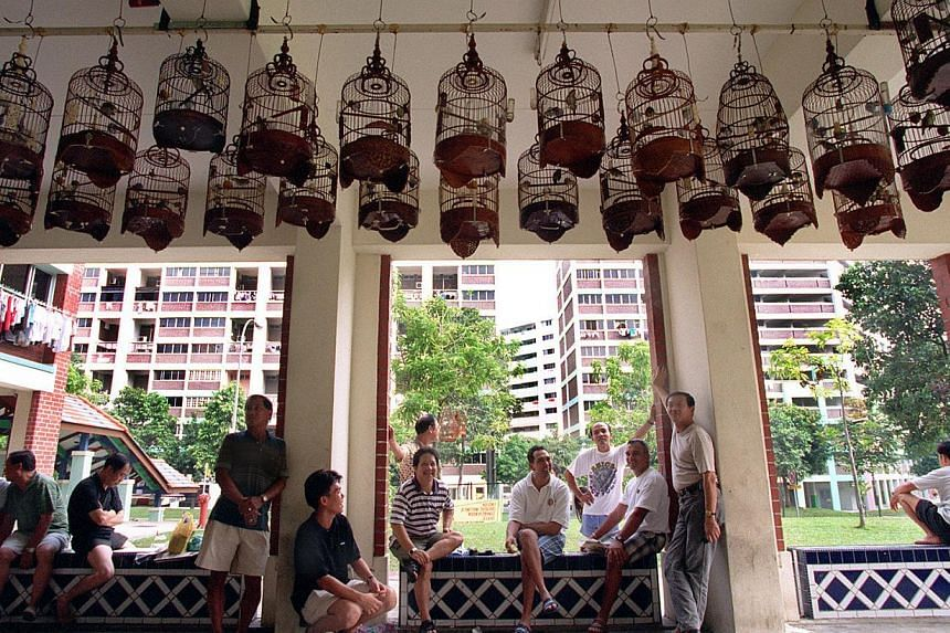 Residents bonding over their shared interest in birds in a void deck in Yishun. A void deck has many social uses, said Mr Chan Chun Sing, and instead of infringing on these spaces, childcare centres can be designed upfront into the second storey or c