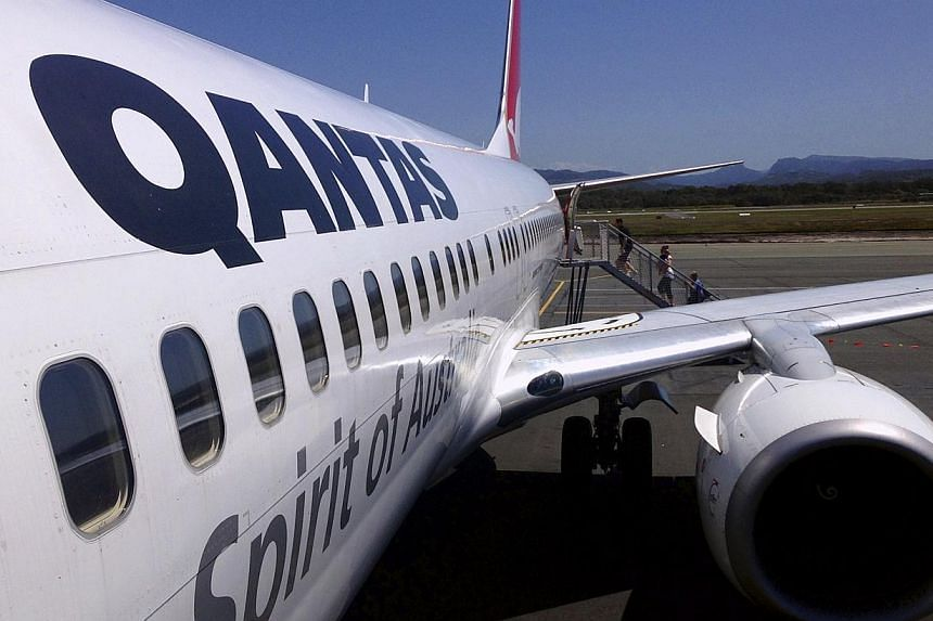 Australian carrier Qantas on Thursday roared back into the black after an aggressive shake-up to stem mounting losses, posting its best interim result in four years. -- PHOTO: REUTERS