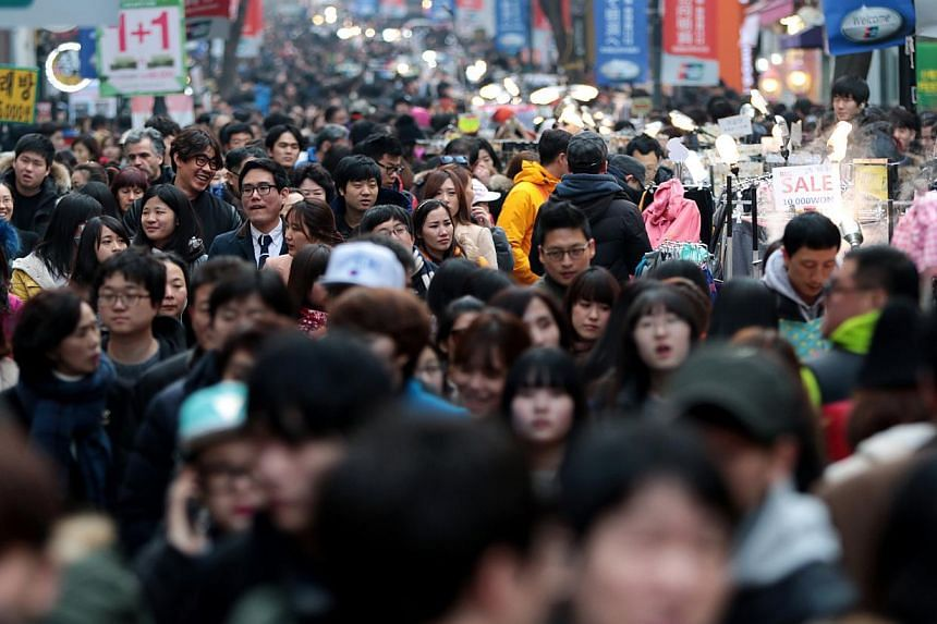 Shoppers and pedestrians in the Myeongdong shopping district of Seoul, South Korea, on Sunday, Feb 15, 2015.South Korea's Constitutional Court is set to rule Thursday on a motion to strike down a controversial law that outlaws adultery and thre