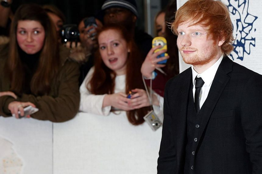 Singer Ed Sheeran arrives for the Brit music awards at the O2 Arena in Greenwich, London, Feb 25, 2015. -- PHOTO: REUTERS