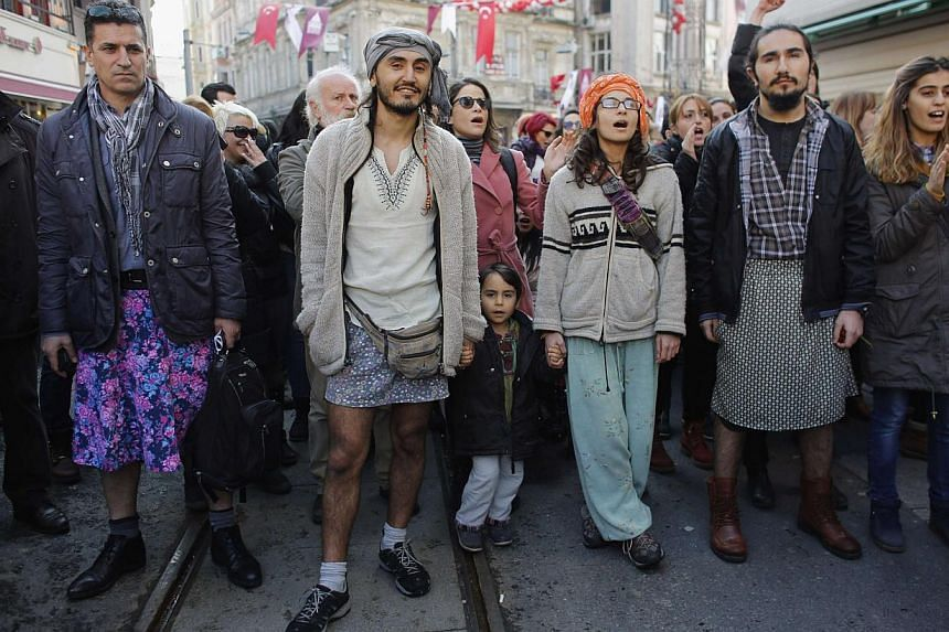 Turkish men wearing skirts demonstrate in Istanbul, to support women's rights in memory of 20-year-old Ozgecan Aslan, who was murdered after she resisted an alleged attempted rape in the southern city of Mersin, on Feb 21, 2015. -- PHOTO: REUTERS