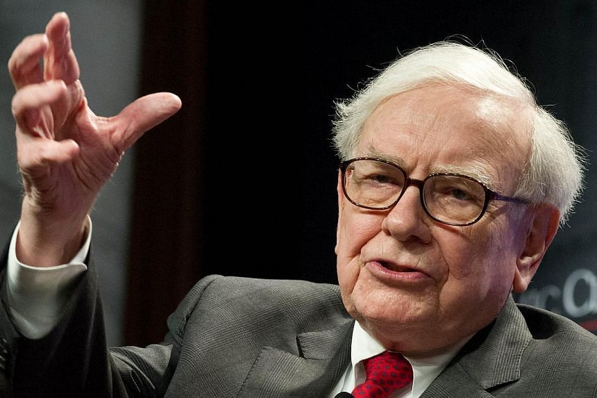 Warren Buffett, chief executive officer of Berkshire Hathaway Inc, told investors on Saturday that he has found his successor. -- PHOTO: AFP
