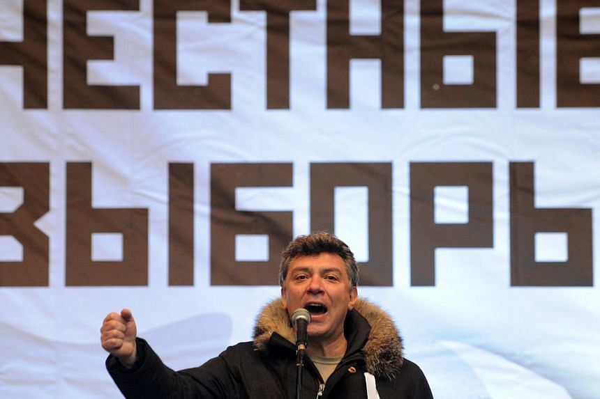 A picture take on December 24, 2011 in Moscow shows one of the leader of the opposition Boris Nemtsov speaking during a rally against the December 4 parliament elections in Moscow. -- PHOTO: AFP