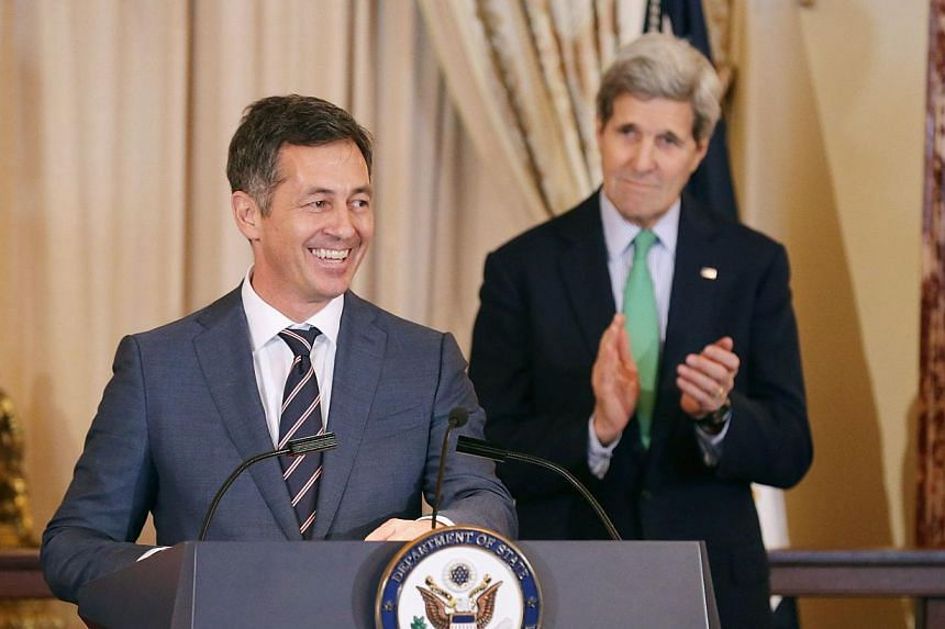 MrRandy Berry (left), the first-ever Special Envoy for the Human Rights of Lesbian, Gay, Bisexual and Transgender Persons, delivers remarks during a reception in his honour with US Secretary of State John Kerry in the Ben Franklin Room at the D